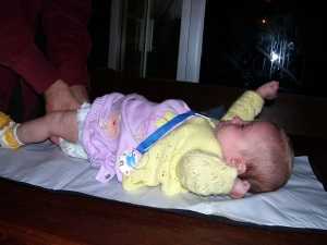 My daughter, 3 months, getting changed on a pub table in Toronto.