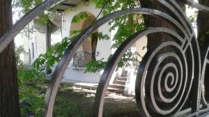 Gorky House Museum through the rail fence