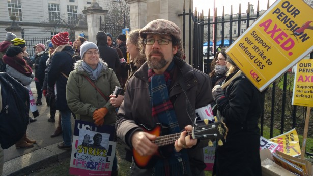 Michael Munnik playing ukulele at the UCU picket line at Cardiff University