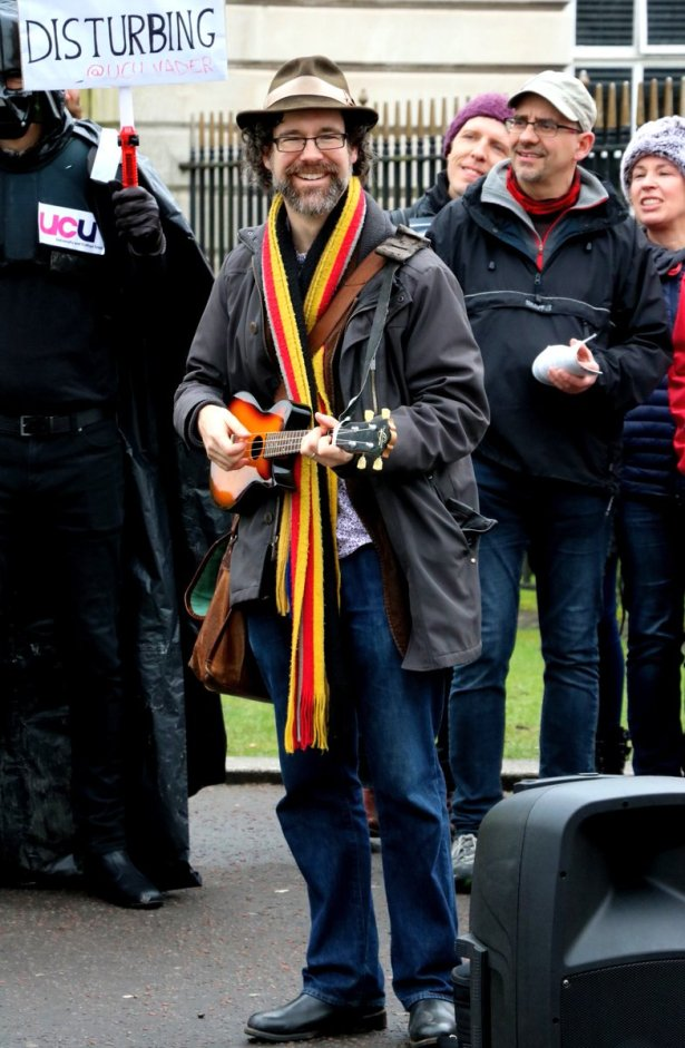 Michael Munnik playing ukulele at Cardiff UCU rally,8 March 2012