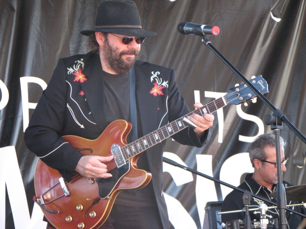 Colin Linden playing guitar at Toronto PartiGras