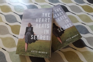 Two copies of Katie Munnik's The Heart Beats in Secret on a tablecloth
