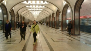 Mayakovskaya Metro station in Moscow, with arches and a train blurred as it rushes past